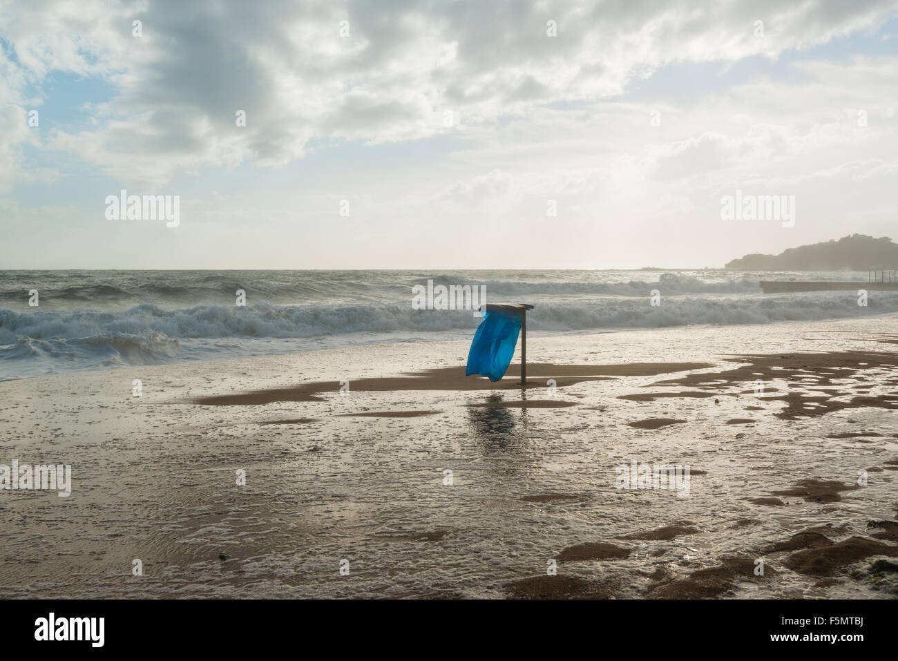 Trash can on the beach - Stock Image