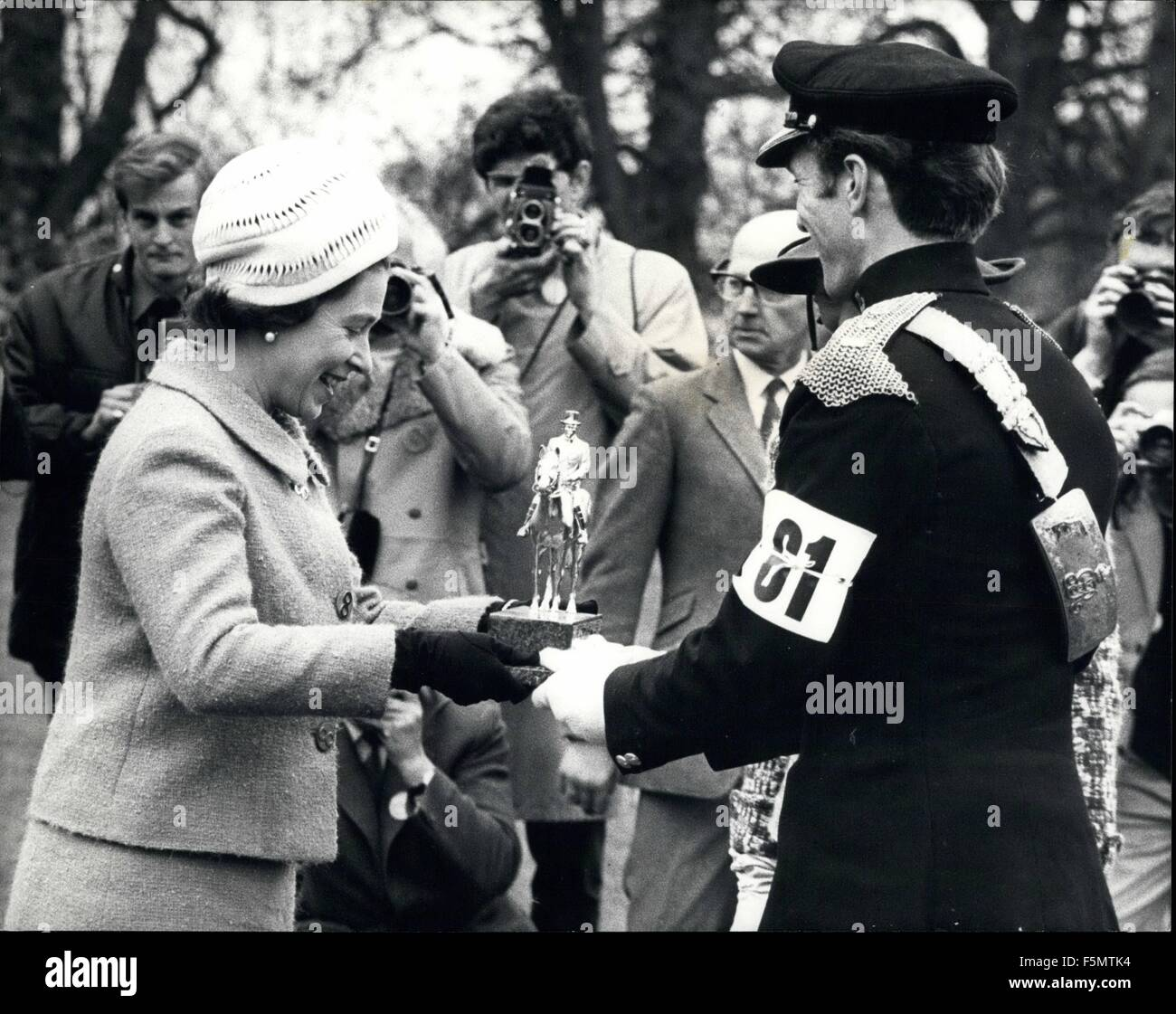 1954 - Her Majesty The Queen presents the winners trophy to Mark Phillips - her future son-in-law?? For the second Stock Photo