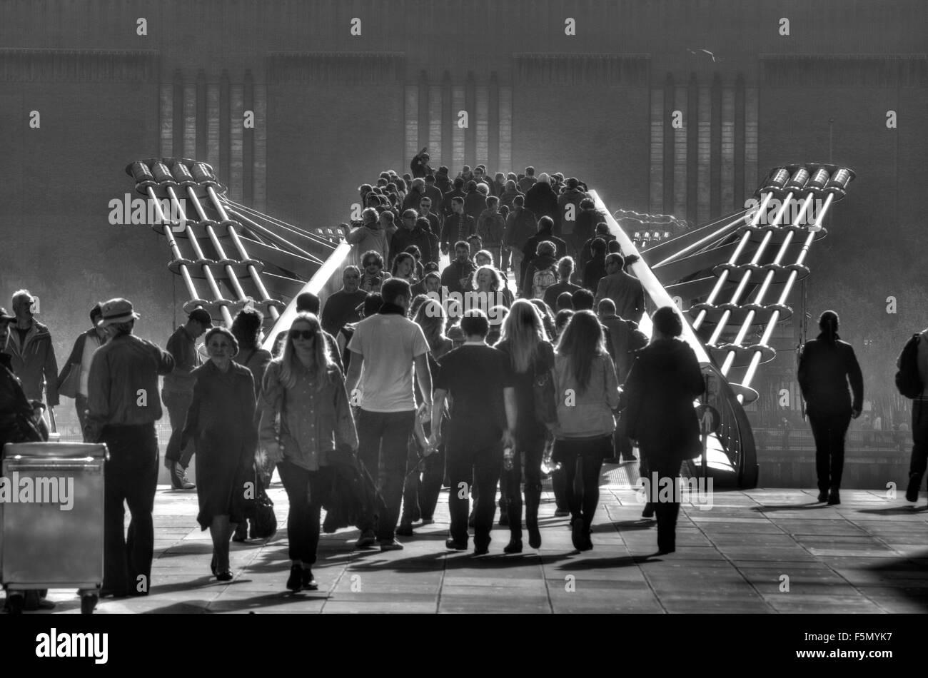 millennium bridge,   crowds on bridge,  people on bridge - Stock Image