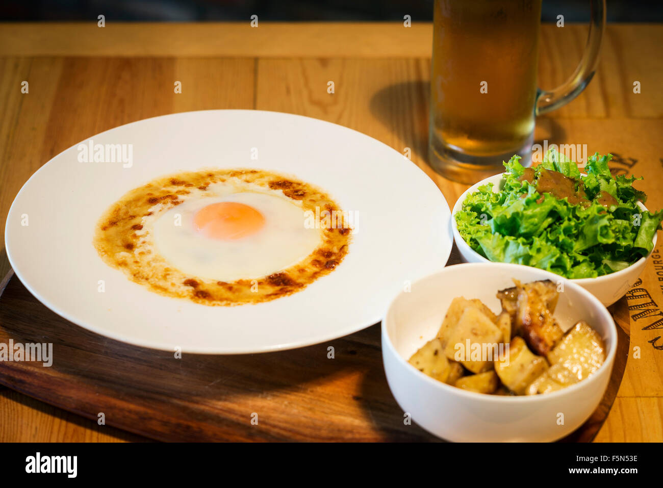northern france local specialty dish the welsh with meat, egg and melted cheese - Stock Image
