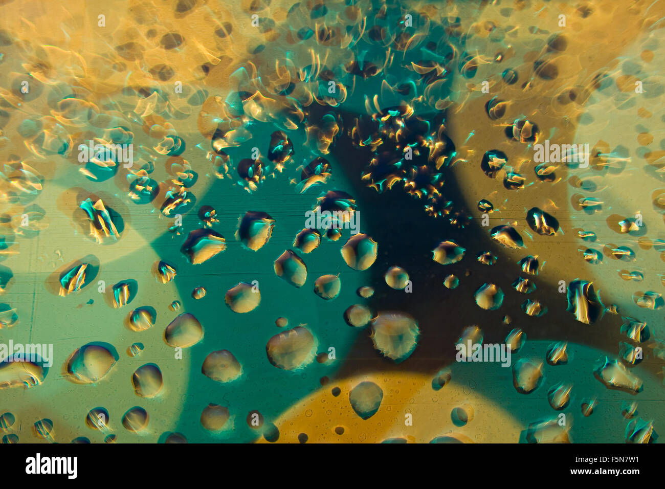 Abstract and psychedelic color background with water drops. - Stock Image