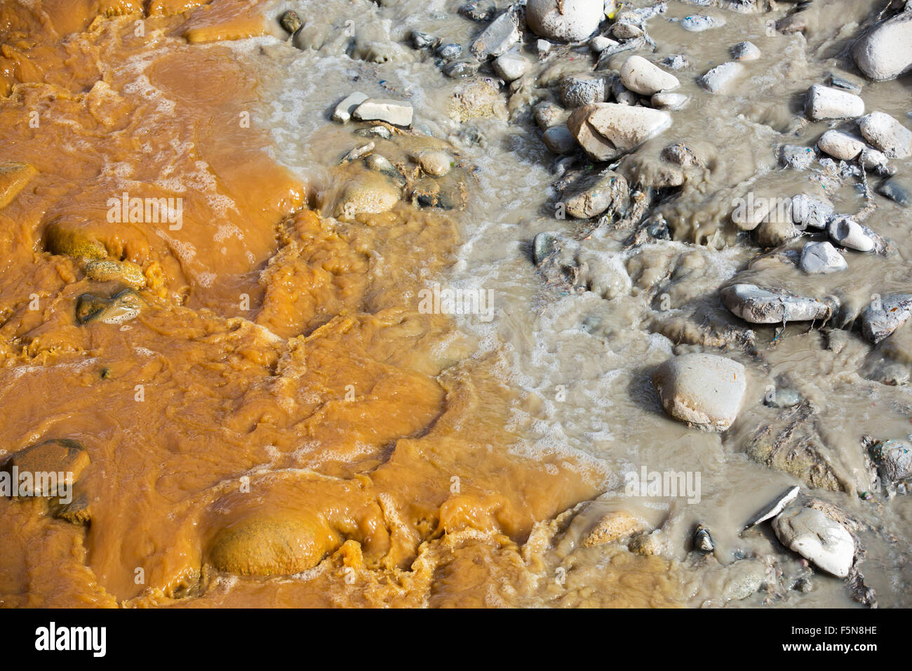 A river full of water contaminated by mine effluent, mixing with raw sewage in La Paz, Bolivia. La Paz will probably Stock Photo