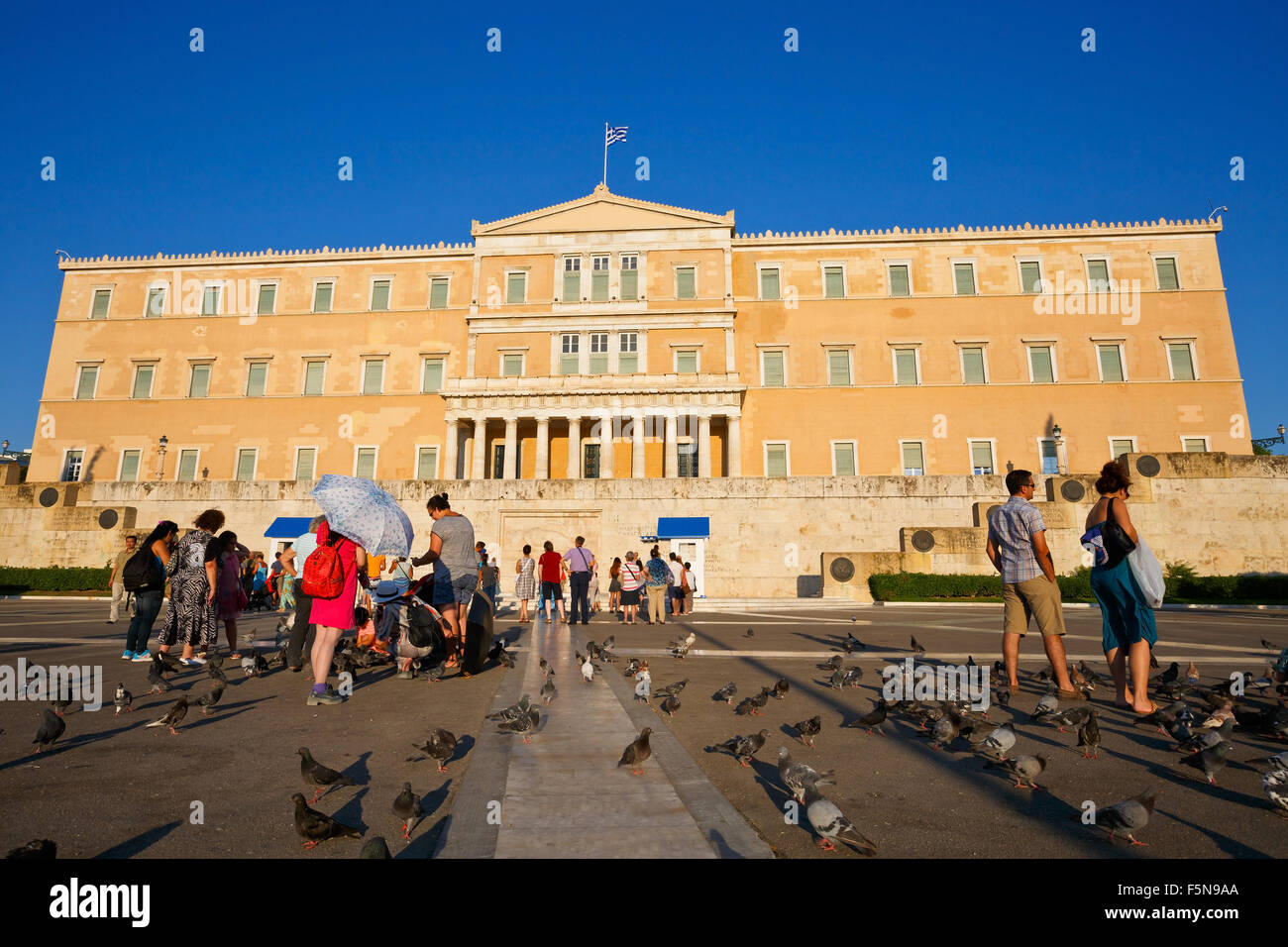 Tourists in front of the building of Greek parliament - Stock Image