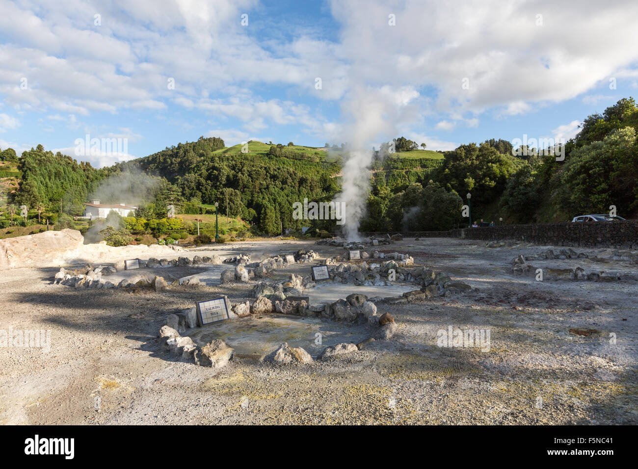 Many geysers, hot-springs and fumaroles scattered in the central village of Furnas, São Miguel, Azores - Stock Image