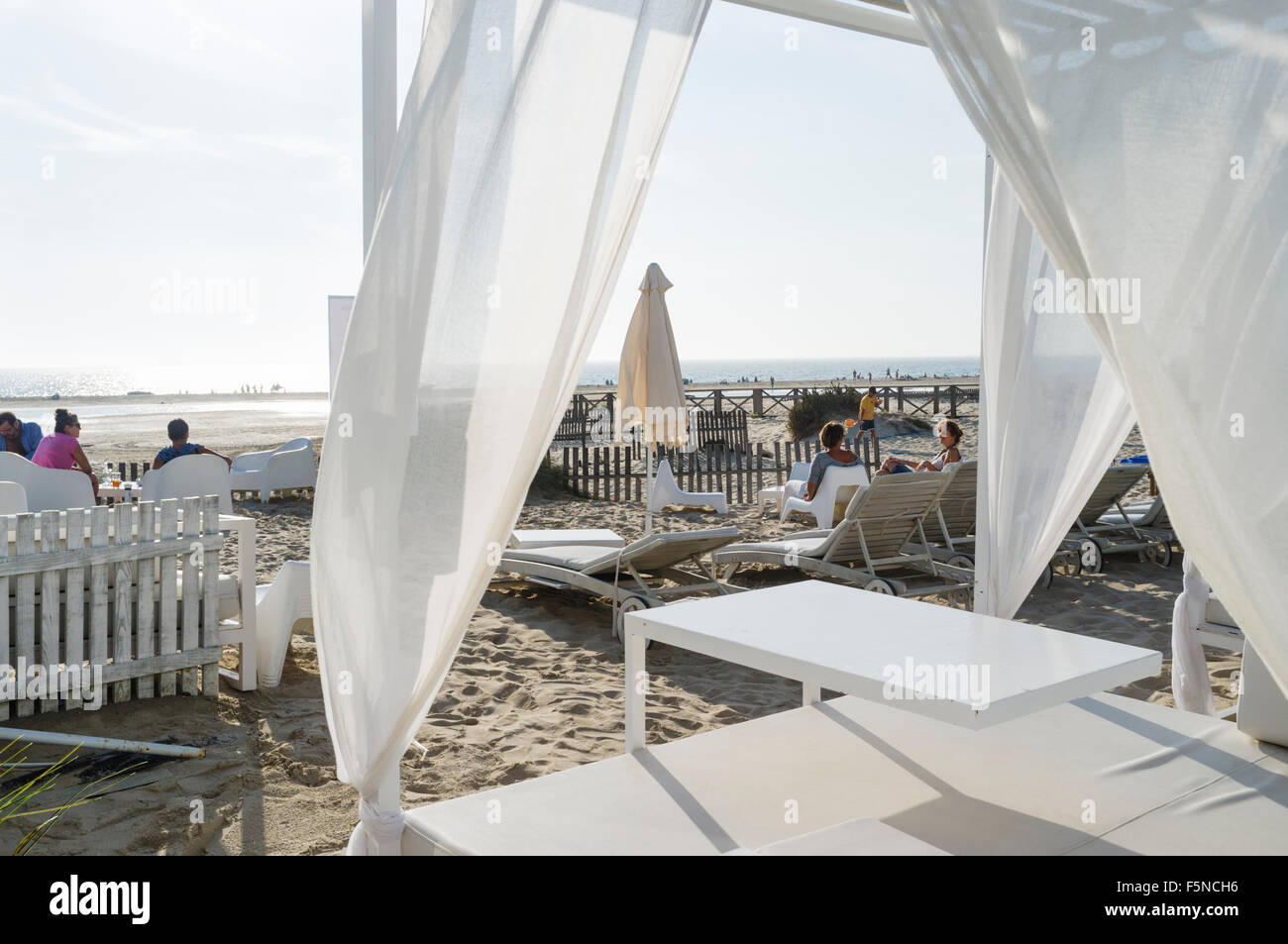 Sunbeds at a chill out beach bar in Tarifa, Cadiz province, Andalusia, Spain - Stock Image