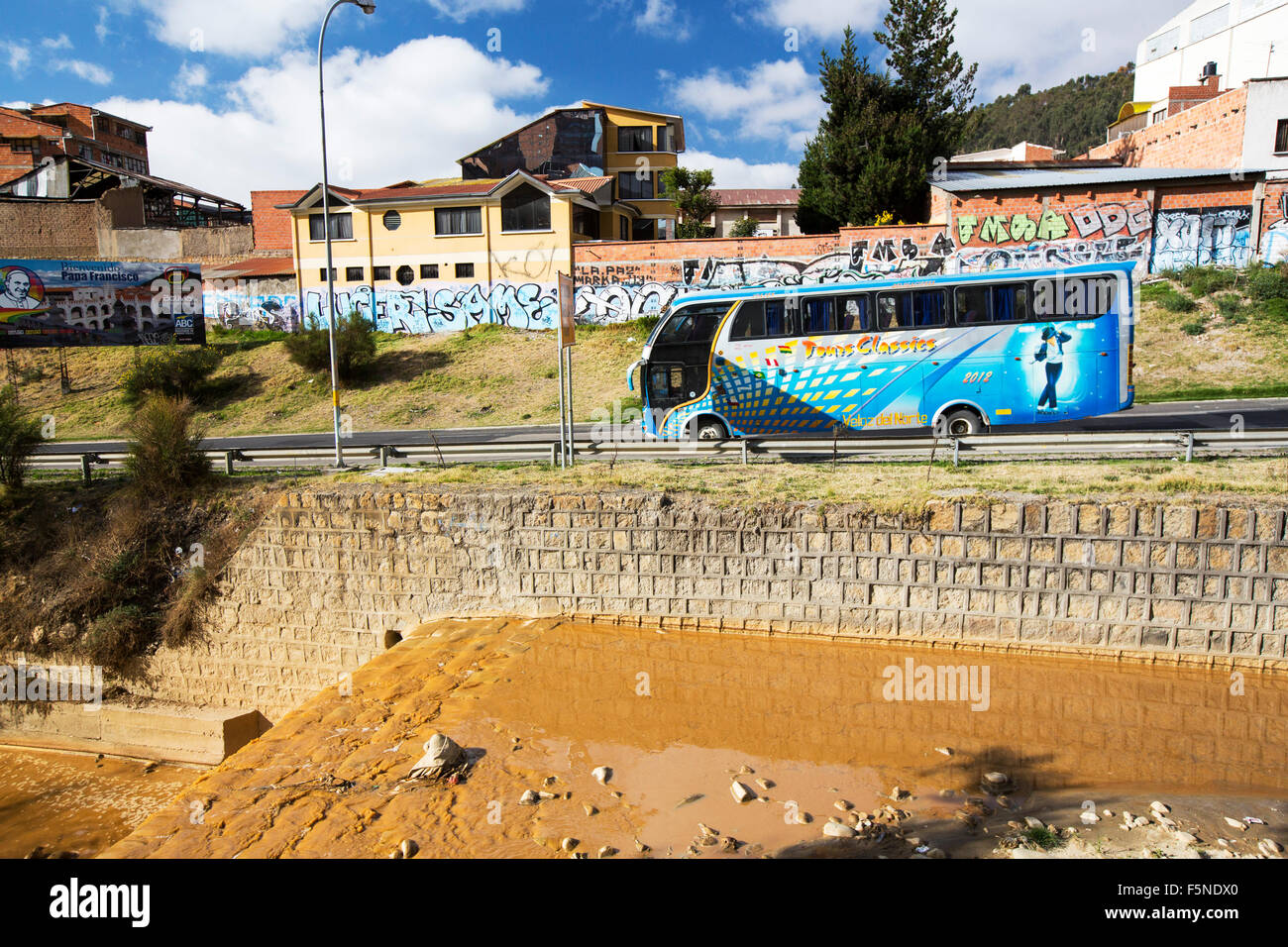 A river full of water contaminated by mine effluent in La Paz, Bolivia. La Paz will probably be the first capital - Stock Image