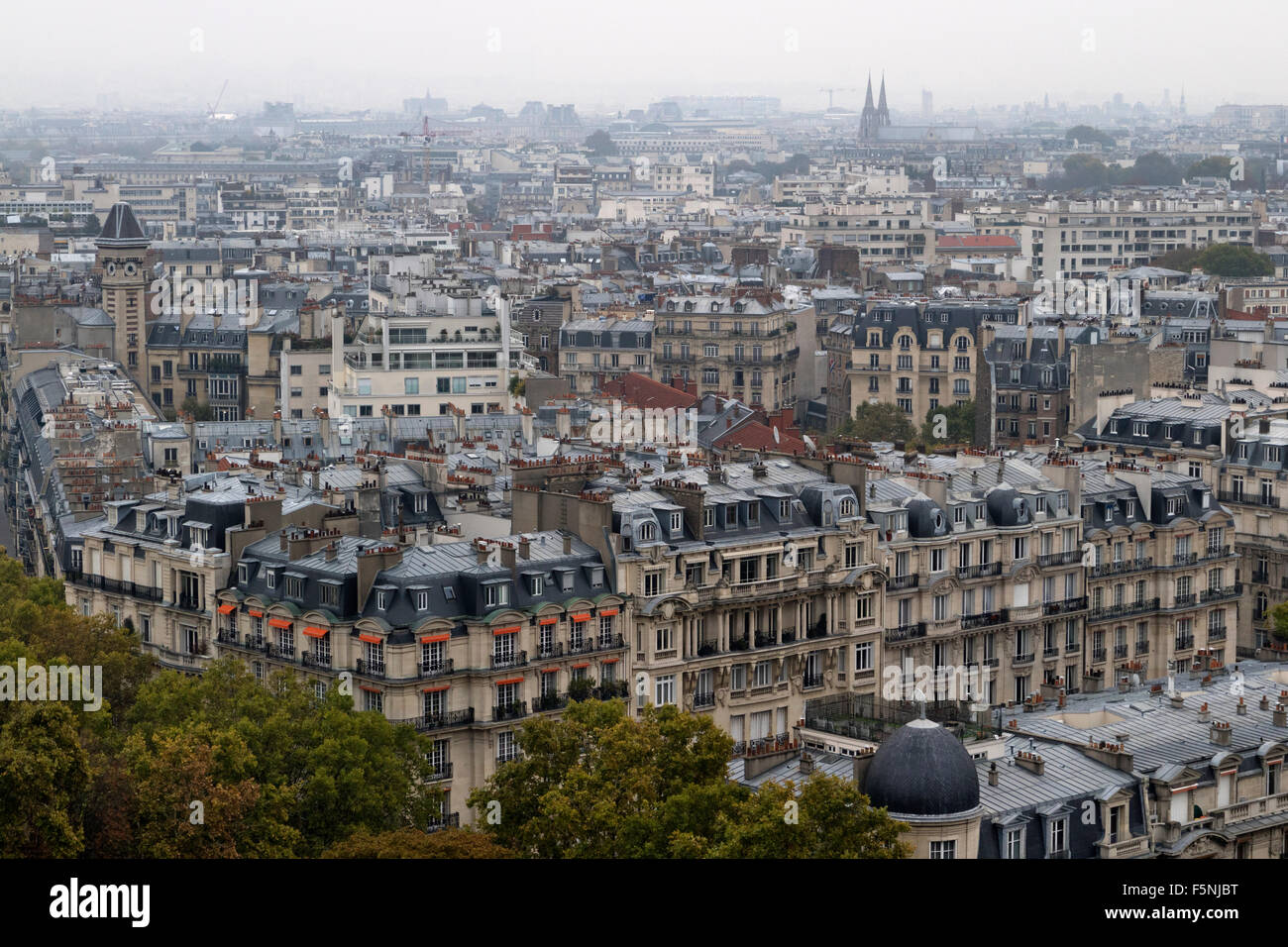 Facades of traditional buildings in autumn in Paris - Stock Image