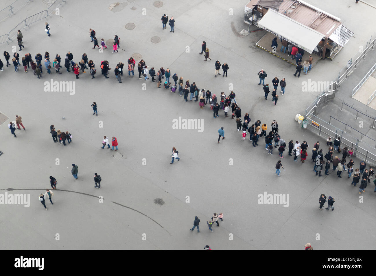 Rows of visitors seen from the Eiffel tower from the glass floor on the first floor - Stock Image