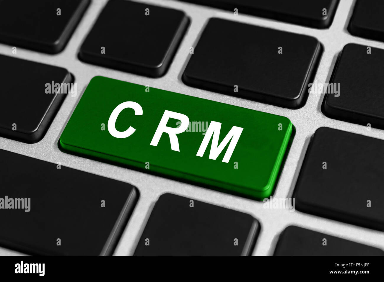 CRM or Customer relationship management button on keyboard, business concept - Stock Image