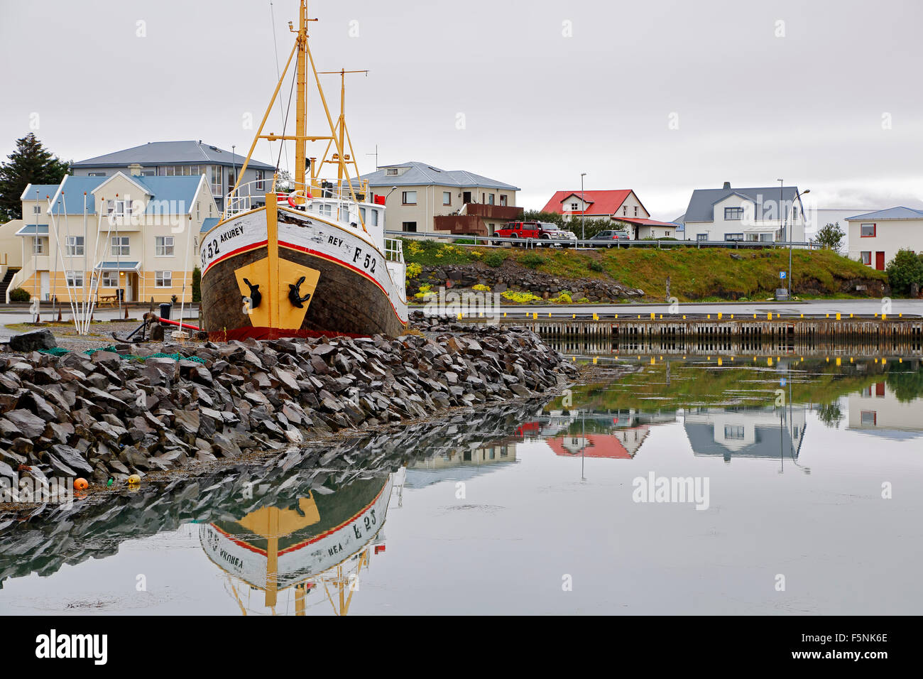 Boat and colorful houses, harbor, Hofn, Iceland Stock Photo