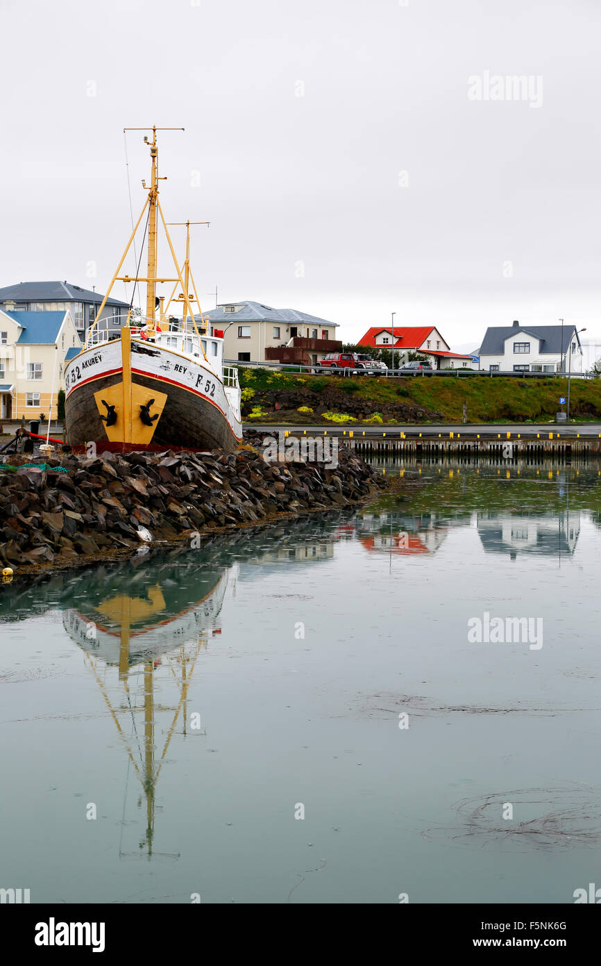 Boat and colorful houses, harbor, Hofn, Iceland - Stock Image