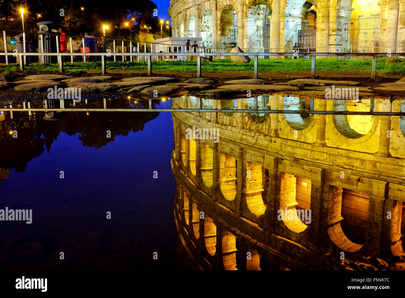 Reflection of the colosseum in the water of a puddle, Rome Italy - Stock Image