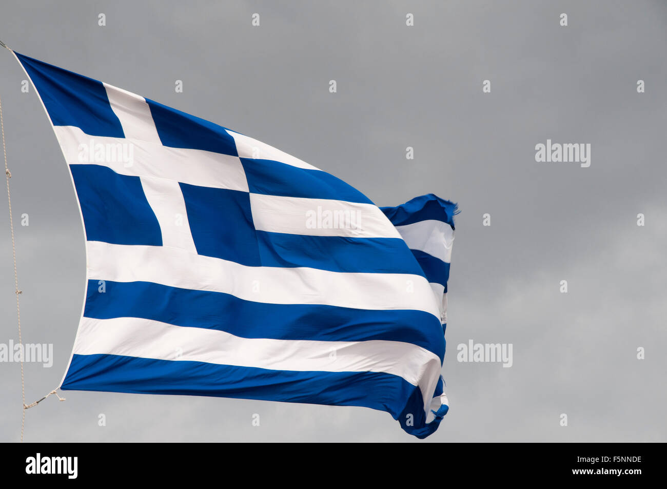 Flag of Greece on top of the Acropolis of Athens.  Griechische Flagge auf der Akropolis in Athen. - Stock Image