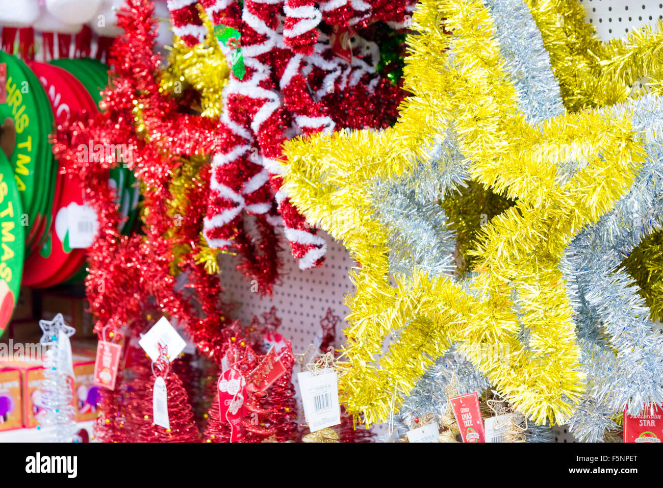 Tinsel star for sale in a store, UK. - Stock Image