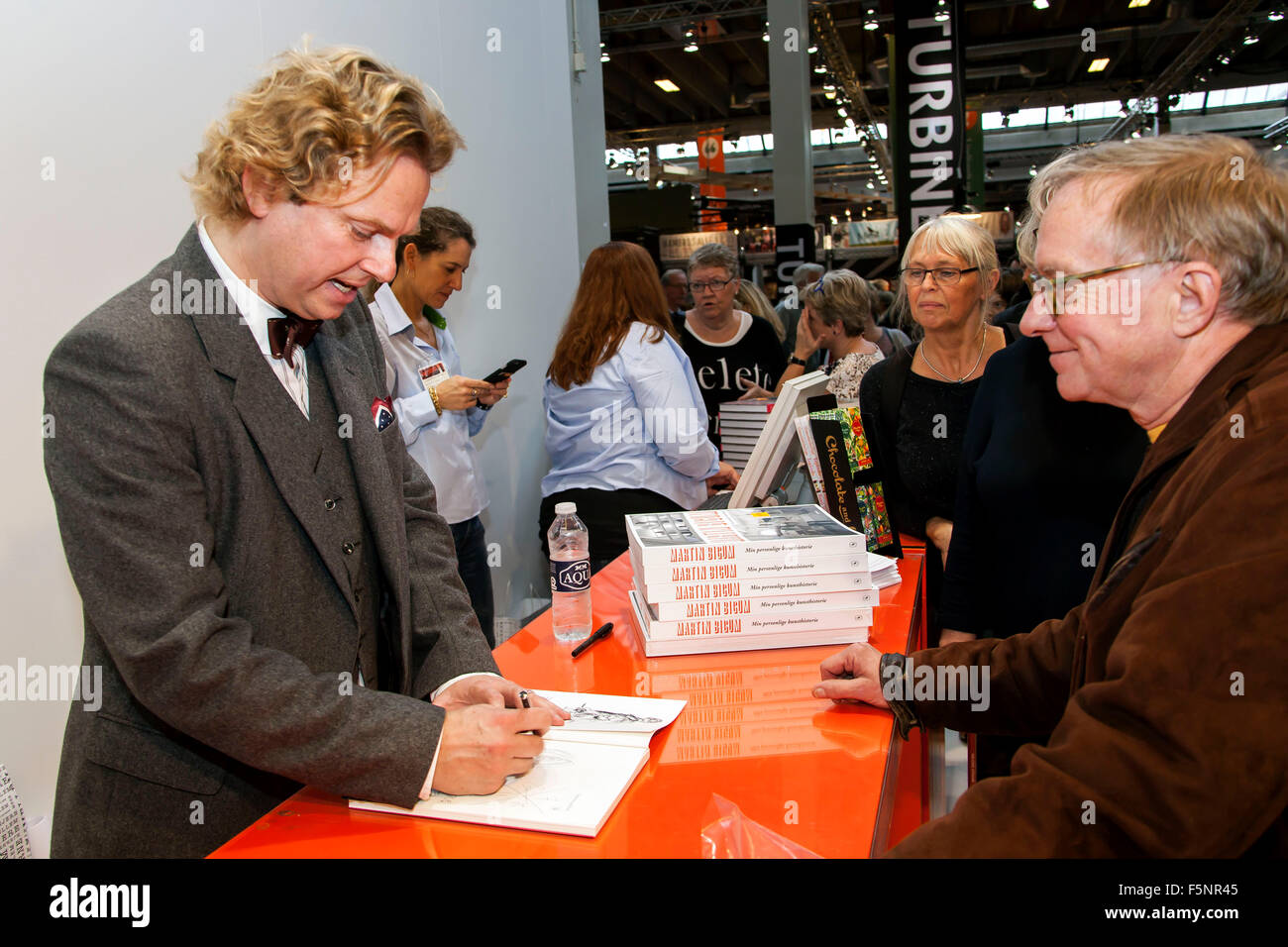 Copenhagen, Denmark, November 7th, 2015. Author Martin Bigum sign his new art book for fans at Copenhagen Bookfair. - Stock Image