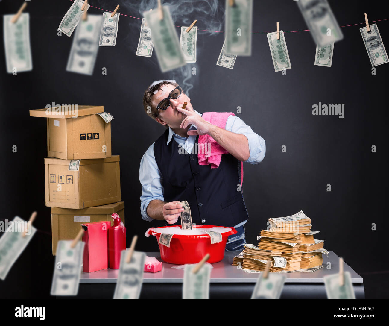 Smoking businessman is laundering money in the basement - Stock Image