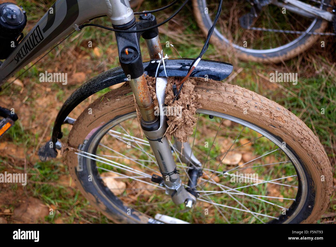 Mud clogged bicycle wheel. - Stock Image