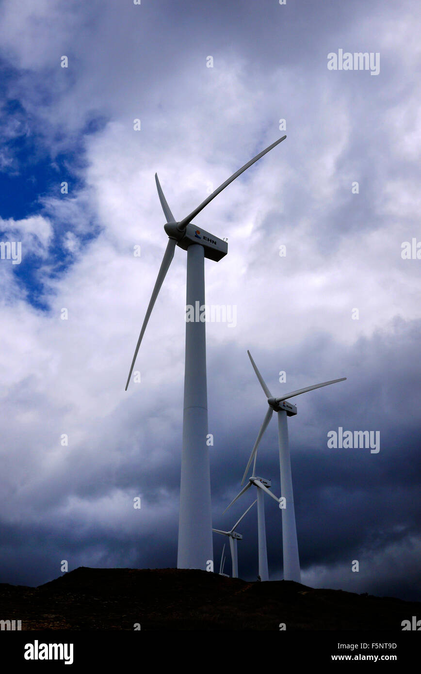 Wind turbines against a stormy sky in Spain. - Stock Image