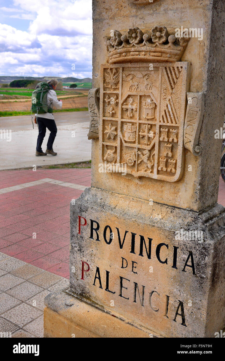 A pilgrim walking the camino to Santiago de Compostella passes a monument marking the start of the Provincia de - Stock Image