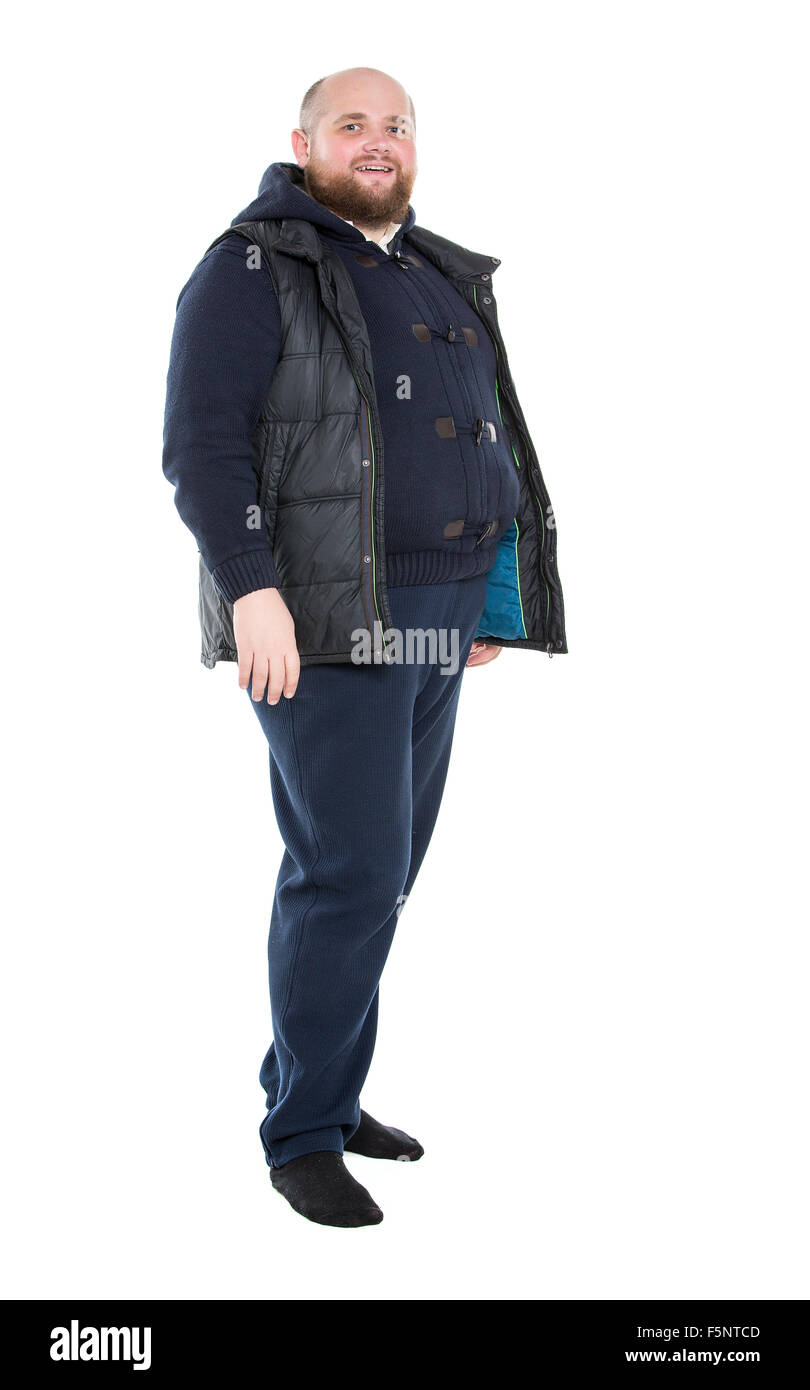 Jolly Fat Man in a Dark Warm Clothes, on white background - Stock Image