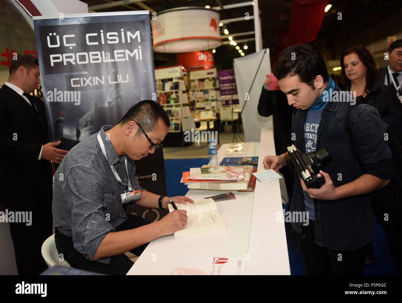 (151107) -- ISTANBUL, Nov. 7, 2015(Xinhua) -- Chinese sci-fi writer Liu Cixin (L) signs on his work 'The Three - Stock Image
