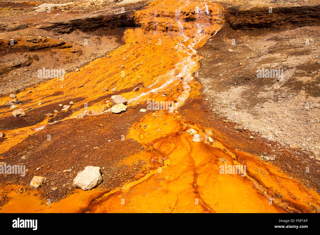 Contaminated mine effluent leaking out of a mine on Chacaltaya peak in the Bolivian Andes. - Stock Image