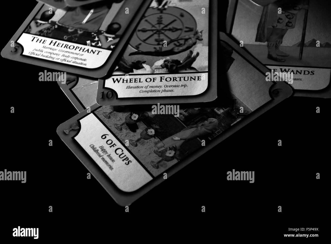 tarot cards,tarot the fool,the sun.,five,psychic,fortune teller,gypsy - Stock Image