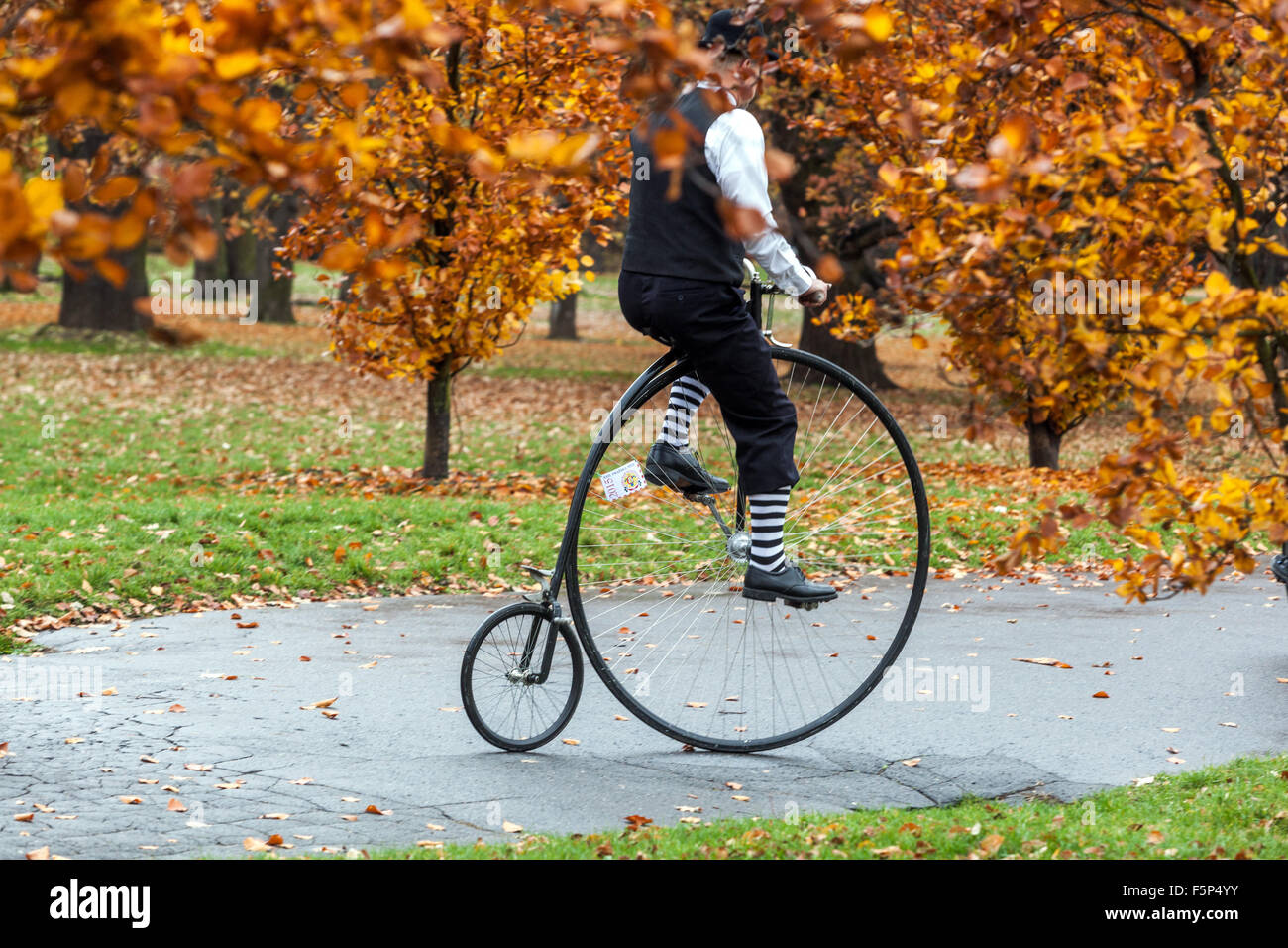 Prague Autumn, Traditional Penny Farthing bicycle race. Participants dressed in period costumes, Prague Letna Park, - Stock Image