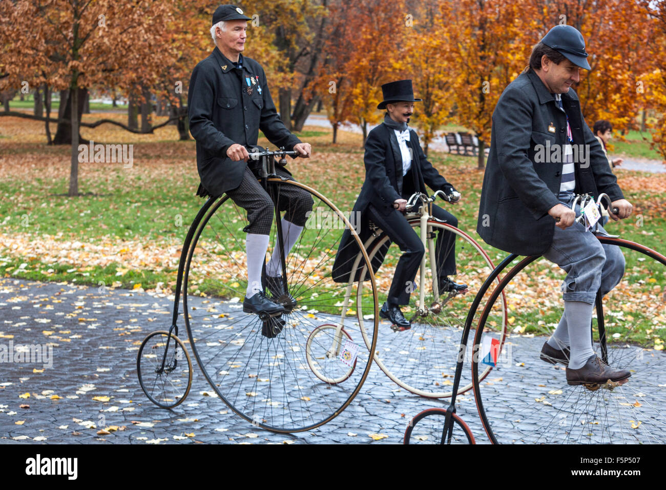 Traditional Penny Farthing bicycle race. Participants dressed in period costumes, Letna Park, Prague, Czech Republic - Stock Image