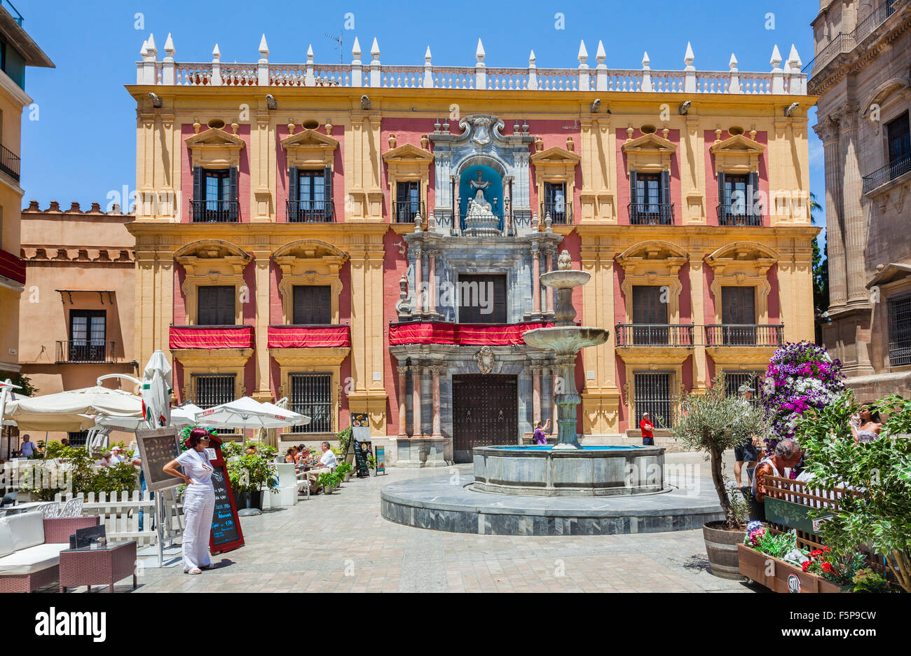 view of the Palacio Episcopal, Bishop's Palace with Plaza del Obispo Fountain at Plaza del Obispo, Malaga, Andalusia, - Stock Image