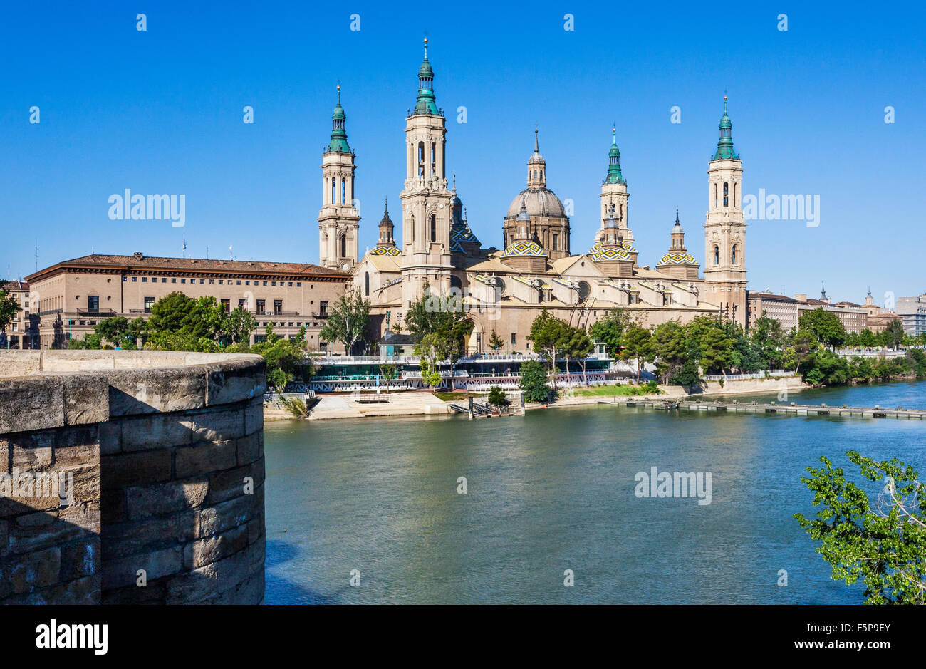 Spain, Aragon, Zaragoza, view of the Baroque style Basilica-Cathedral of Our Lady of the Pillar across the Ebro - Stock Image