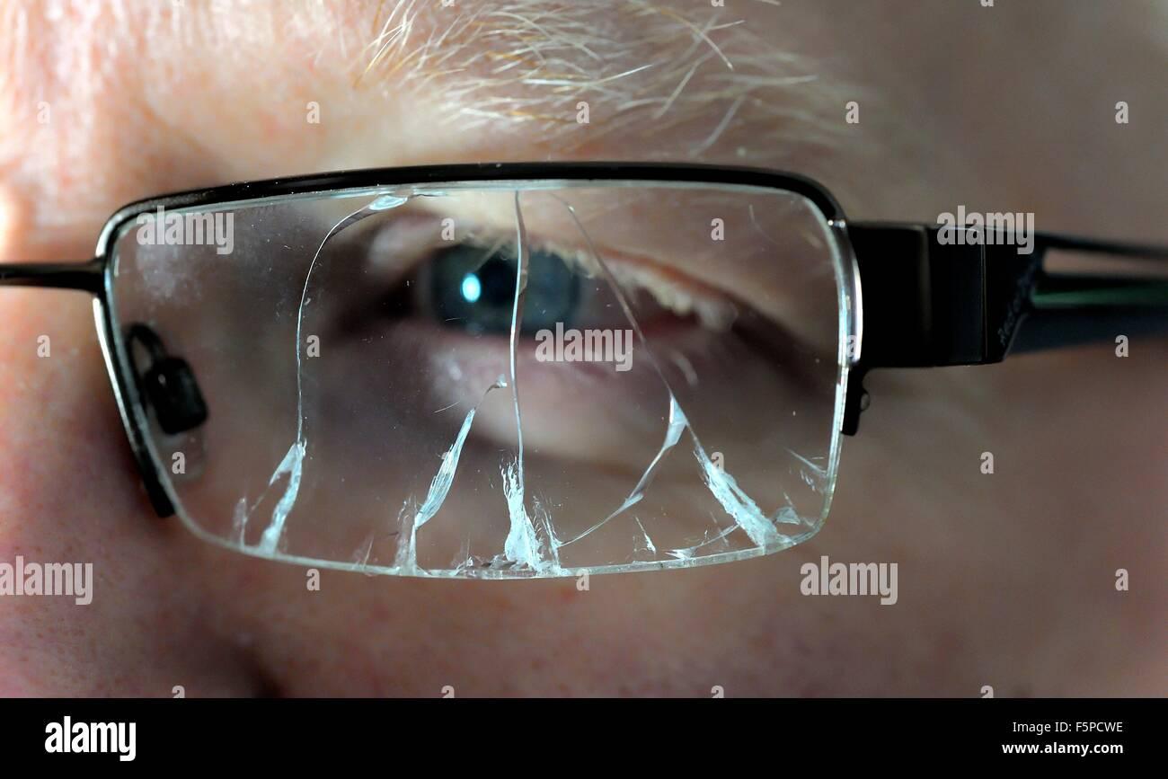 man wearing broken spectacles Stock Photo