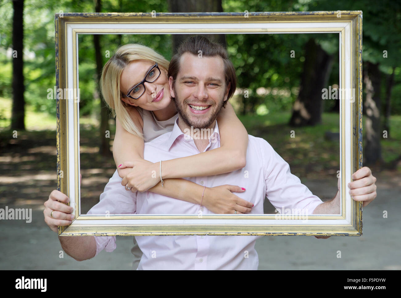 Delighted married couple taking the conceptual photo - Stock Image