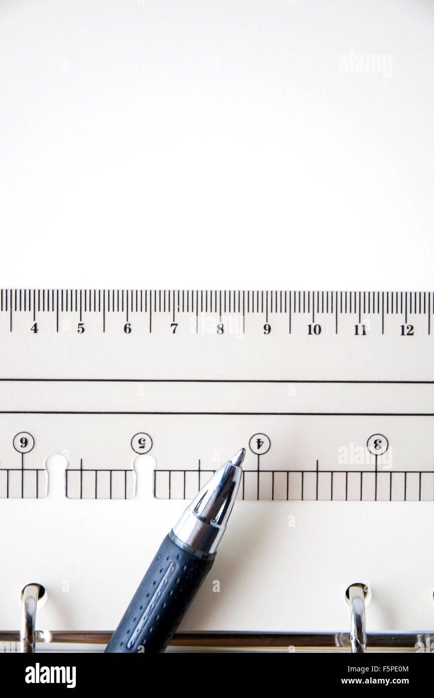 pen point to scale on white paper - Stock Image
