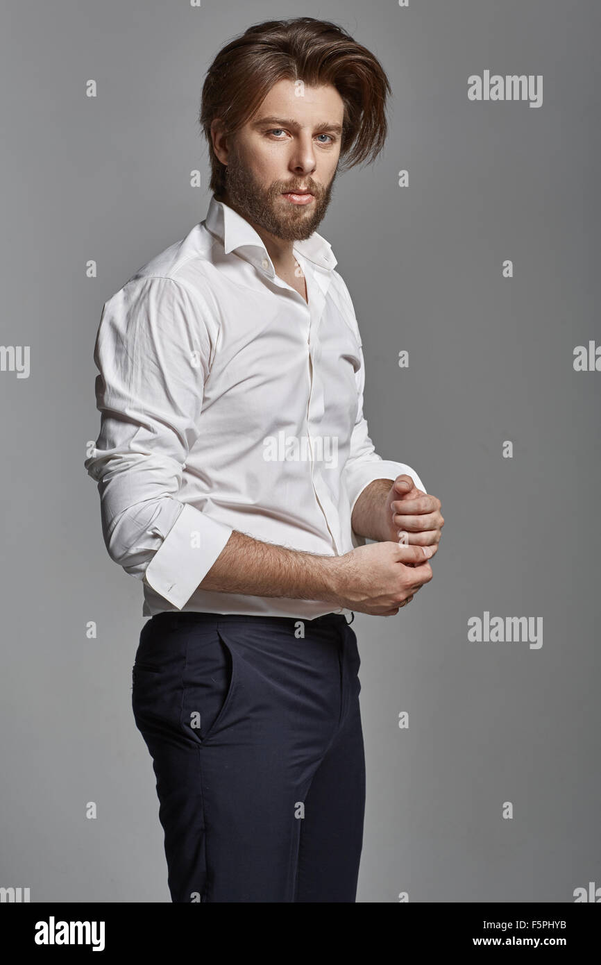 Portrait of a stylish man with casual clothes - Stock Image
