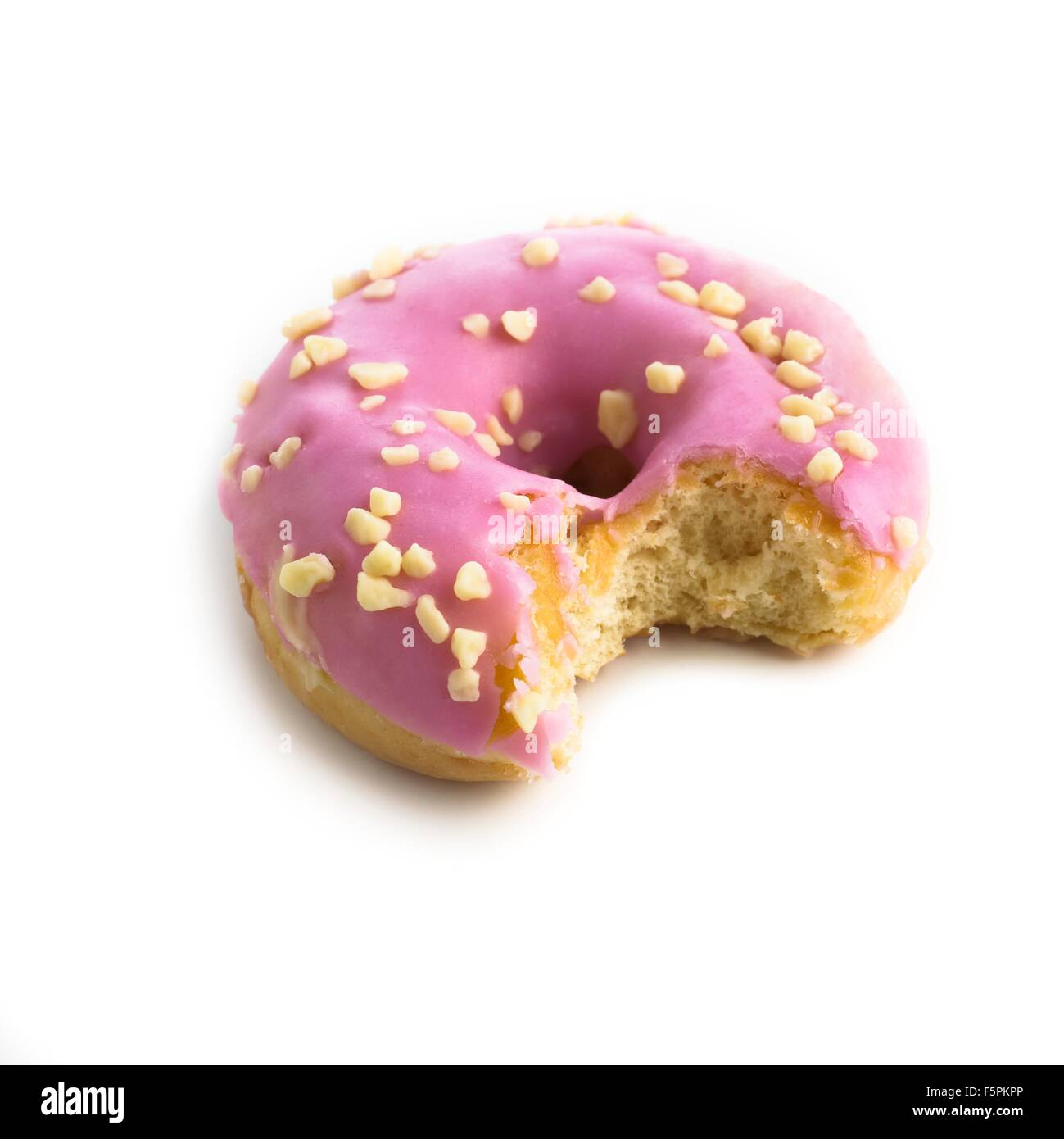 Pink doughnut with a missing bite against a white background. - Stock Image