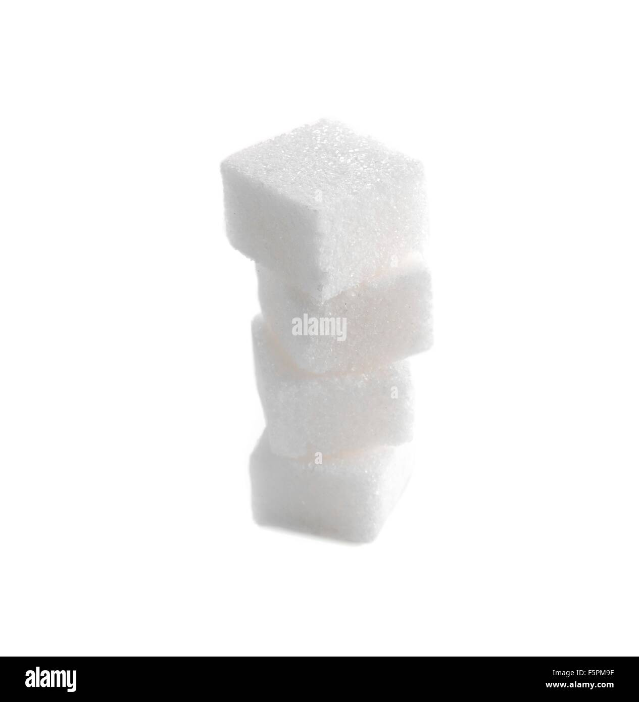 Sugar lumps against a white background. - Stock Image