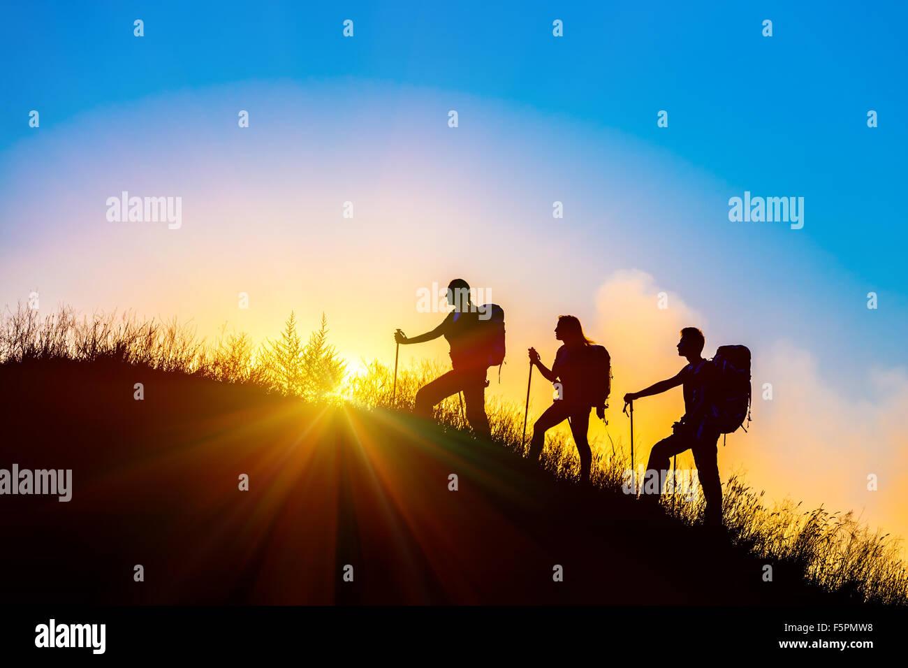 People meeting sunrise team building session - Stock Image