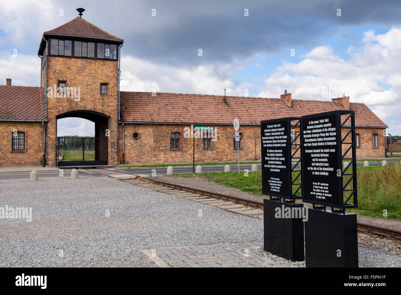 Information boards outside entrance gate to Auschwitz II-Birkenau German Nazi Concentration and Extermination Death - Stock Image