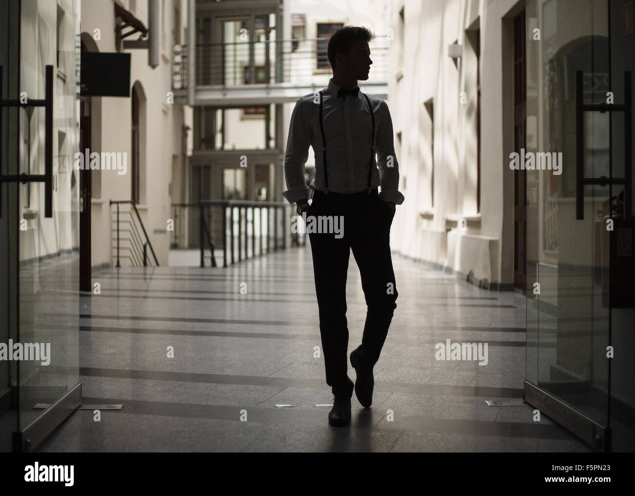 Smart man walking in the building - Stock Image