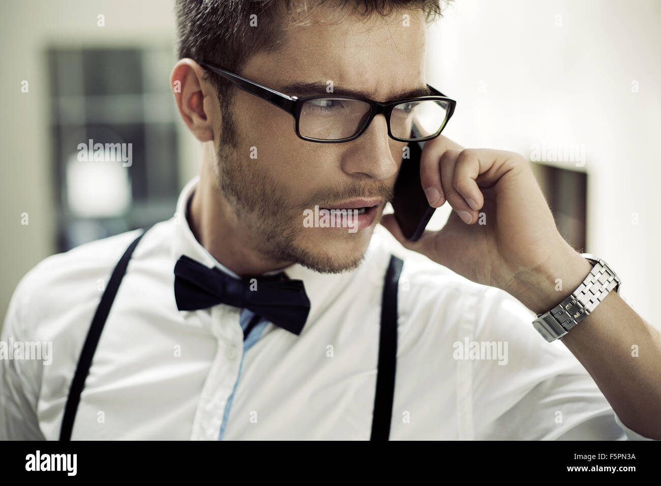 Closeup portrait of a phoning businessman - Stock Image