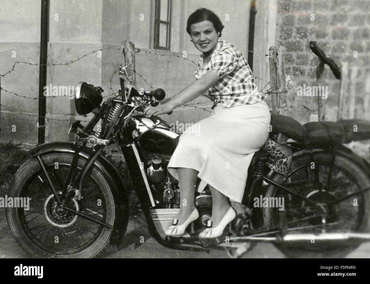 Women on Moto Guzzi motorbike, Italy - Stock Image