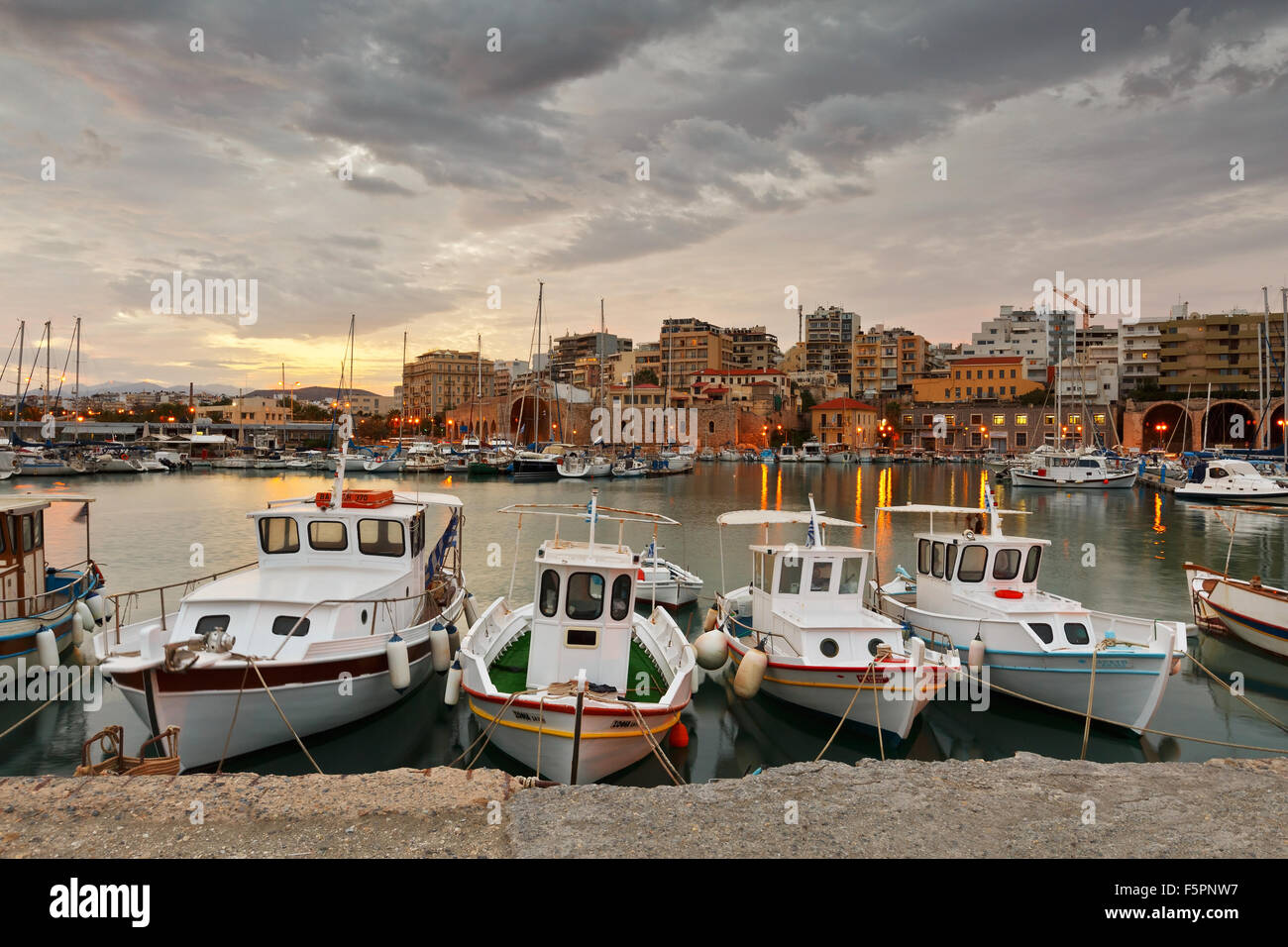 Old harbour with fishing boats and marina in Heraklion, Crete, Greece - Stock Image