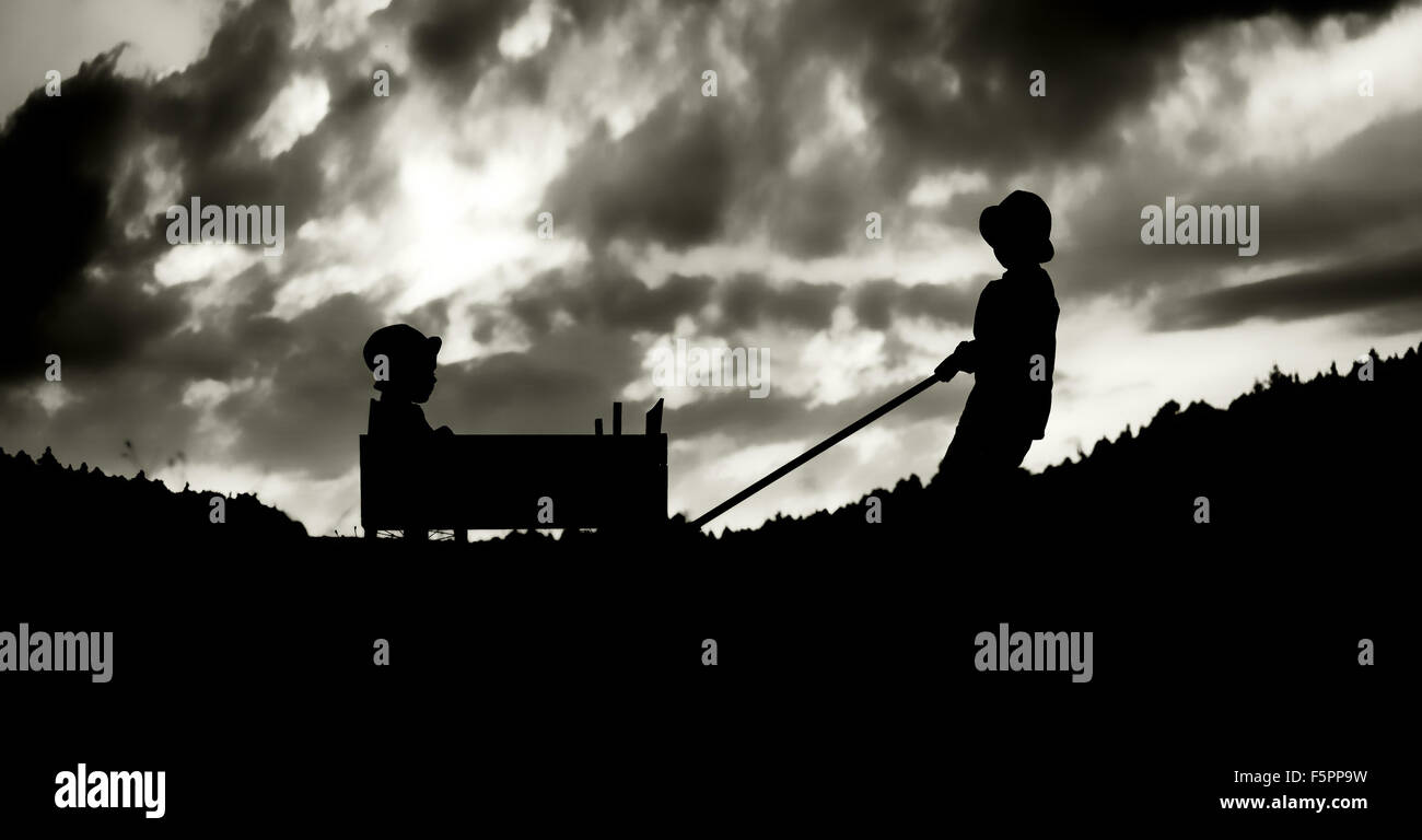 Family amusement with the carriage in the evening - Stock Image