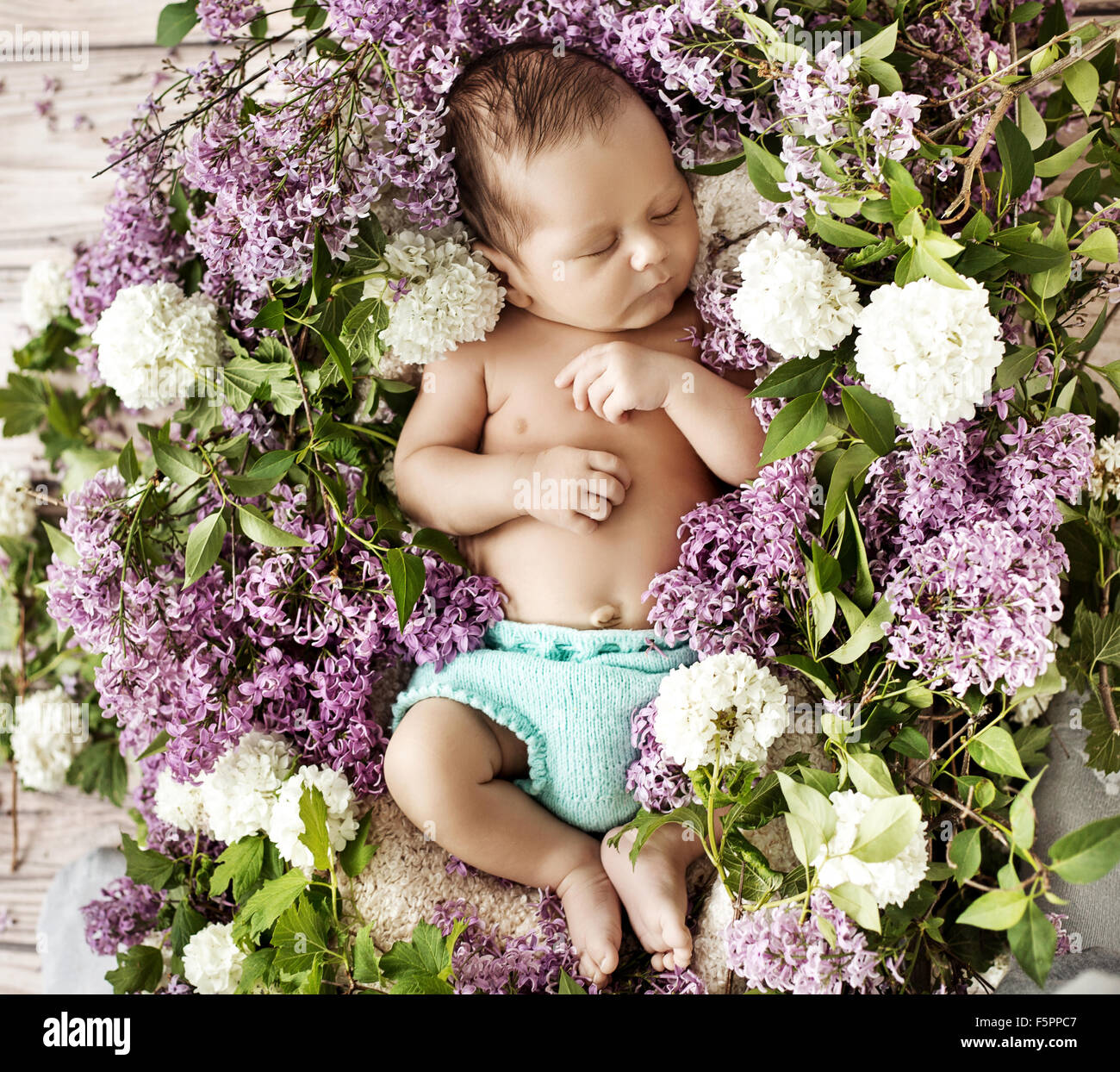 Cute baby sleeping on the chaplet - Stock Image