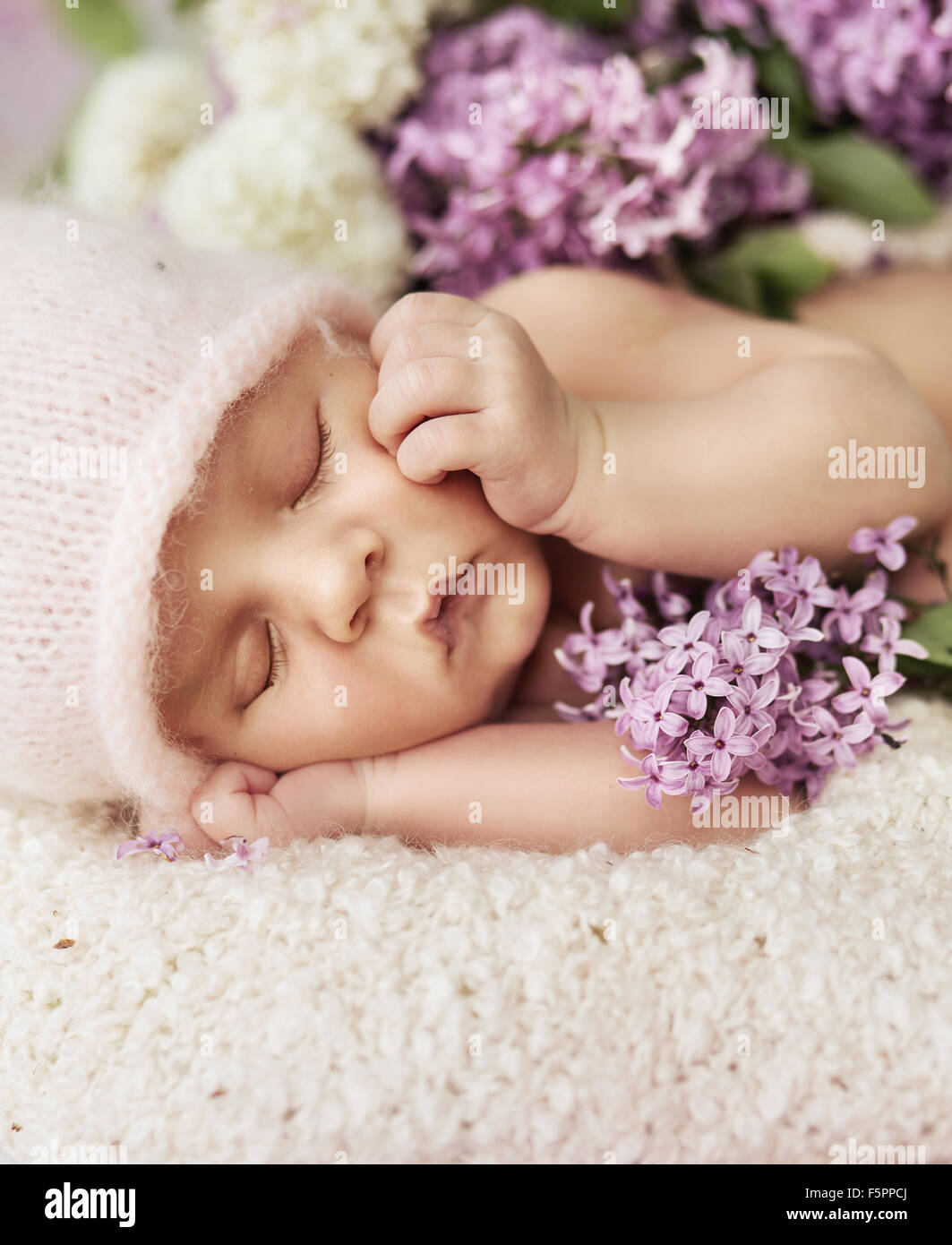 Cute newborn child sleeping on the soft carpet Stock Photo