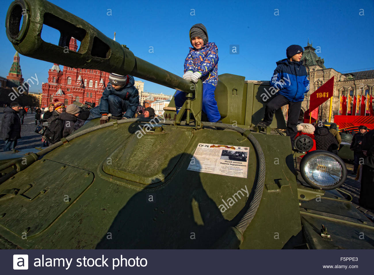 Moskva, Russia. November 7th, 2015. RUSSIA, Moscow: Children are seen on a tank on the Red Square during a parade - Stock Image