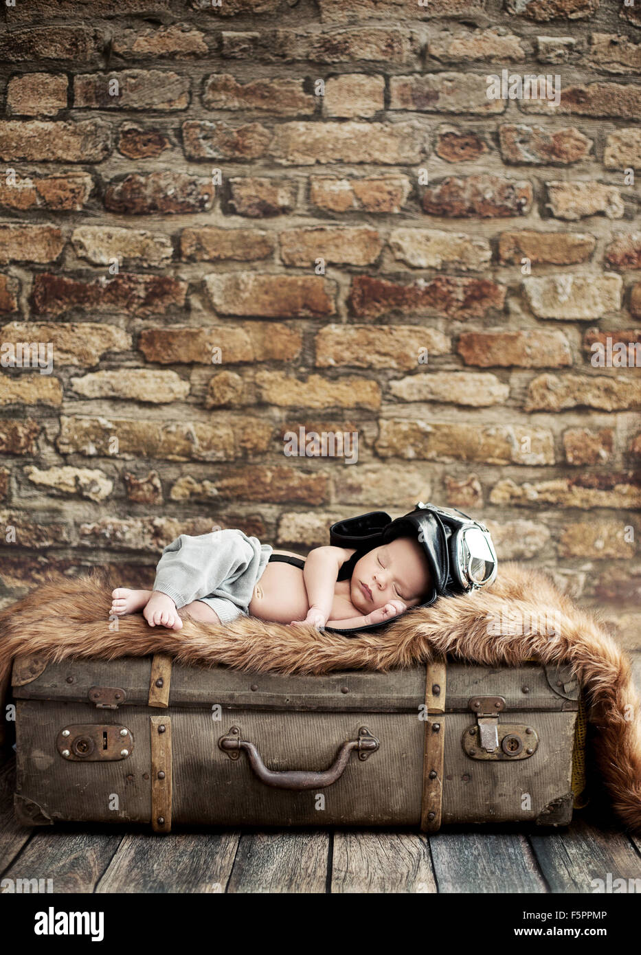 Little cute pilot sleeping on the suitcase - Stock Image