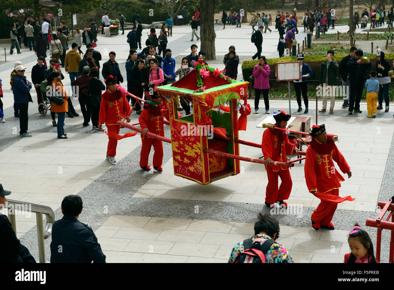 People tourists emperor carriage ride pretend Beijing Botanical Garden RM Floral - Stock Image