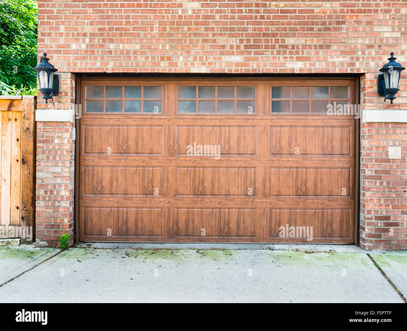 High End Garage Door On A Brick House Of A Upscale Neighborhood